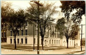 1940s MONROE, Wisconsin RPPC Photo Postcard HIGH SCHOOL Building  / Street View
