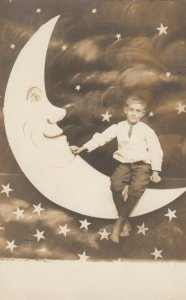 RP: Child sitting on a paper moon , AKRON , Ohio , 00-10s