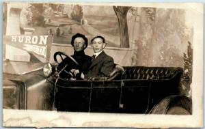1910s HURON, South Dakota RPPC Studio Photo Postcard / 2 Young Men in Automobile