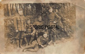 WW1 SOLDIERS IN UNIFORM POSE FOR PHOTO~1910s REAL PHOTO MILITARY POSTCARD
