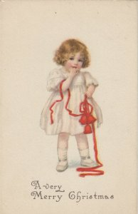 CHRISTMAS , 1900-10s ; Girl with red ribbon
