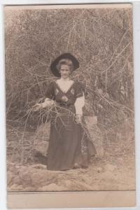 RPPC, Woman with a Hat in the Bushes
