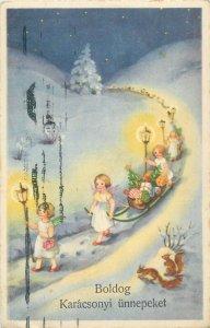 Winter fantasy Christmas greetings cherub angels gifts sledge lamp fantasy 1940s