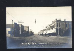 RPPC MILES CITY MONTANA DOWNTOWN MAIN STREET SCENE OLD REAL PHOTO POSTCARD