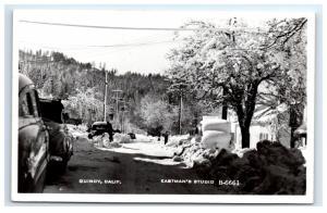 Postcard Quincy, CA Winter Scene Snow Streets cars residential RPPC H12