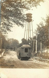 Plymouth Ohio~Closeup of Trolley & Engineer on Dirt St by Watertower~RPPC 1910