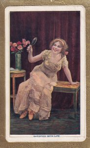 Woman looking at mirror , 1900-10s ; Satisfied with life