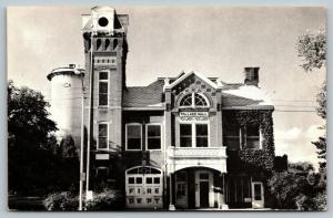Ithaca Michigan~Village Hall~Fire Department~Water Tower Tank~1950s B&W Postcard