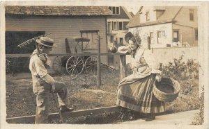 H56/ Milwaukee Wisconsin RPPC Postcard 1910 Man Woman Farm Wagon Rake