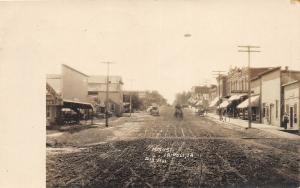 F35/ Tripoli Iowa RPPC Postcard 1911 Main Street Stores Dirt