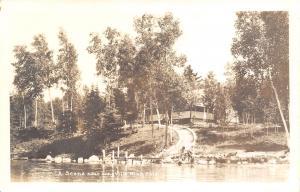 Longville Minnesota~Waterfront Home on Hillside~Kids in Water by Dock~1940s RPPC