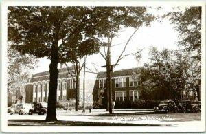 ST. JOHNS, Michigan RPPC Photo Postcard HIGH SCHOOL Building / Street View 1963