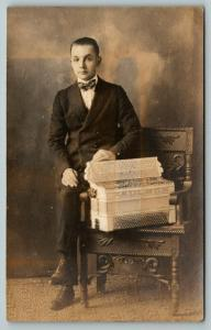 RPPC Young Man w/Bow Tie And Paulson Band? White Accordion~Ornate Chair~c1914
