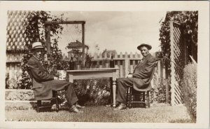 Two Men Sitting Table With Bottles Alcohol ? Outdoors Unused RPPC Postcard G15