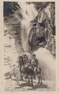 RP; Man and Woman on Donkeys, 1900-10s