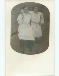 Pre-1918 rppc SISTERS - PRETTY GIRLS WITH ARMS AROUND EACH OTHER o1910