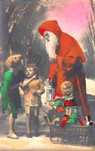 Christmas Orange Suited Santa Claus Boy & Girl Real Photo Postcard