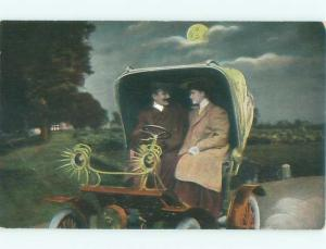Pre-Linen COUPLE IN VERY OLD ANTIQUE AUTOMOBILE CAR AB8225
