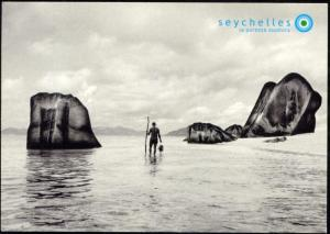 seychelles, DIGUE, Lonely Man on Beach between Rocks