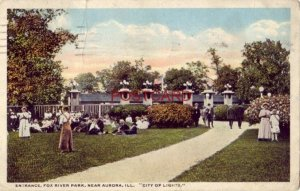 1916 ENTRANCE, FOX RIVER PARK, near AURORA, ILL. City of Lights crowd on lawn