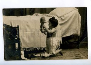 234049 Little GIRL playing w/ DOLL Bed Vintage PHOTO Stender