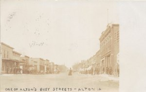 G24/ Alton Iowa RPPC Postcard 1908 Busy Street Main Stores People