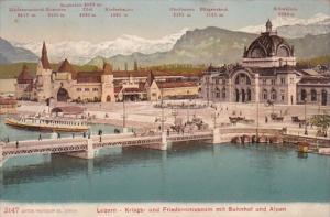 Switzerland Luzern Kruegs- und Friedensmuseum mit Bahnhof und Alpen