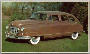 Vintage 1950 NASH AIRFLYTE Automobile Advertising Postcard Brown Car Unused