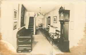 Real Photo Postcard~Hall Interior~Grandfather Clock~Benches, Chandelier~1940s pc