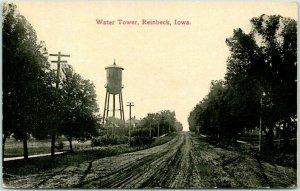 Vintage REINBECK, Iowa Postcard Water Tower Dirt Road View c1910s Unused