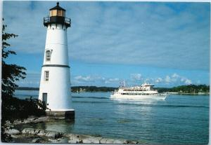 Rock Island Lighthouse and Gananoque Boat Line Thousand Islander III Ontario CAN