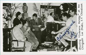 Autographed Chingwah Lee shooting Cinerama Holiday  *RPPC