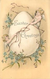 Easter~Angel Cherubs Wrap Ribbon Around Exaggerated Egg~Blue Forget Me Nots~IPCC