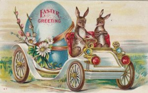 EASTER, 00-10s; Rabbits drivng an automobile with giant egg in back