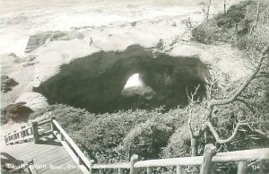 Oregon Coast Highway Devil's Punch Bowl with Man 1950s RPPC Postcard