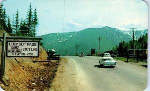LOOKOUT PASS, ID IDAHO/ MONTANA  State Line   c1950s CARS    Postcard