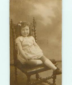 c1910 rppc MINI POSTCARD - CUTE CURLY HAIRED GIRL ON ANTIQUE SPIRAL CHAIR r6730
