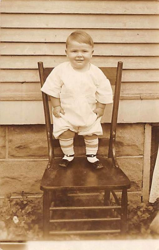 Young child standing on chair Child, People Photo Unused