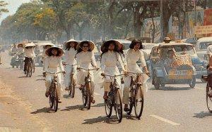 High School Girls Cycling Ao Dai Bicycles Vietnam c1960s Vintage Postcard