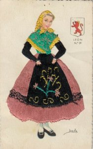 MADRID, Spain, 1930-40s; Woman in embroidered dress, Leon Coat of Arms