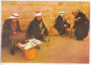 Arab men with waterpipe & board game on sidewalk, Jerusalem,Israel,60-70s Ara...