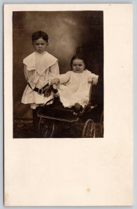 Real Photo Postcard~Victorian Bro & Sis Portrait~Mad Baby Girl in Buggy~c1908