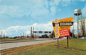 F87/ Sylvania Ohio Postcard Chrome Water Tower Welcome Sign