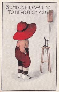 Child wearing big rim red hat staring at stick telephone, Someone is waiting...