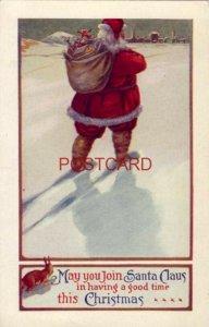 1915 MAY YOU JOIN SANTA CLAUS IN HAVING A GOOD TIME THIS CHRISTMAS Santa & gifts