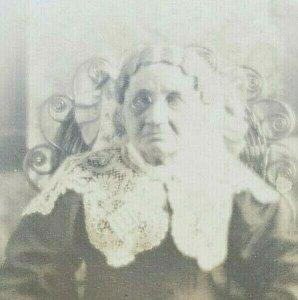 1910 RPPC Postcard Cross-eyed or Blind Elderly Woman Stoic in Wicker Chair