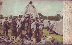 SOLDIERS putting away a tent in an unspecified location, 1900s / MILITARY