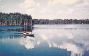 Canoe Drifts Through Puffs of Cloud Reflected in Lake, Brown's Cottages, Engl...