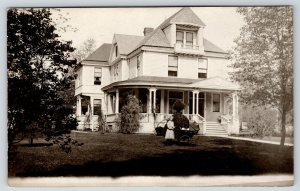 Spring Valley MN~Big T Amiot? Home~Girl w/ Baby Buggy~Travelling Man~1909 RPPC