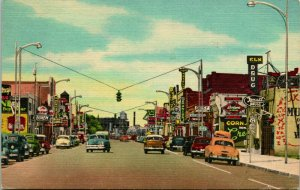 Linen Postcard Tucumcari New Mexico NM Business District Lots of Cars & Signs